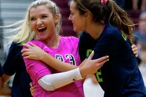 College Park outside hitter Noelle Palmer (2) gets a hug by libero Caley Caffey after an ace in the second set of a non-district high school volleyball match, Friday, Aug. 23, 2019, in Magnolia.
