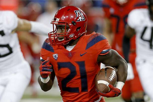 Arizona running back J.J. Taylor (21) runs during an NCAA college football game against Oregon, Saturday, Oct. 27, 2018, in Tucson, Ariz. Arizona is looking for more consistency after a disappointing first season under coach Kevin Sumlin. The Wildcats return several key players, led by quarterback Khalil Tate and running back J.J. Taylor. Arizona opens its season playing at Hawaii on Aug. 24. (AP Photo/Rick Scuteri)