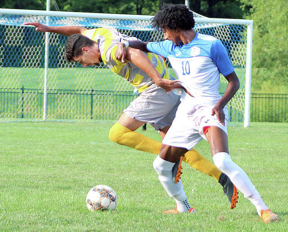 Marshalltown's Jhonatan Brandt, left, gets tangled up with Reshaun Walkes of LCCC Friday evening at Tim Rooney Stadium in Gdfrey. Marshalltown, the No. 2-ranked team in the NJCAA preseason poll, won 4-2. Photo: Pete Hayes | The Telegraph