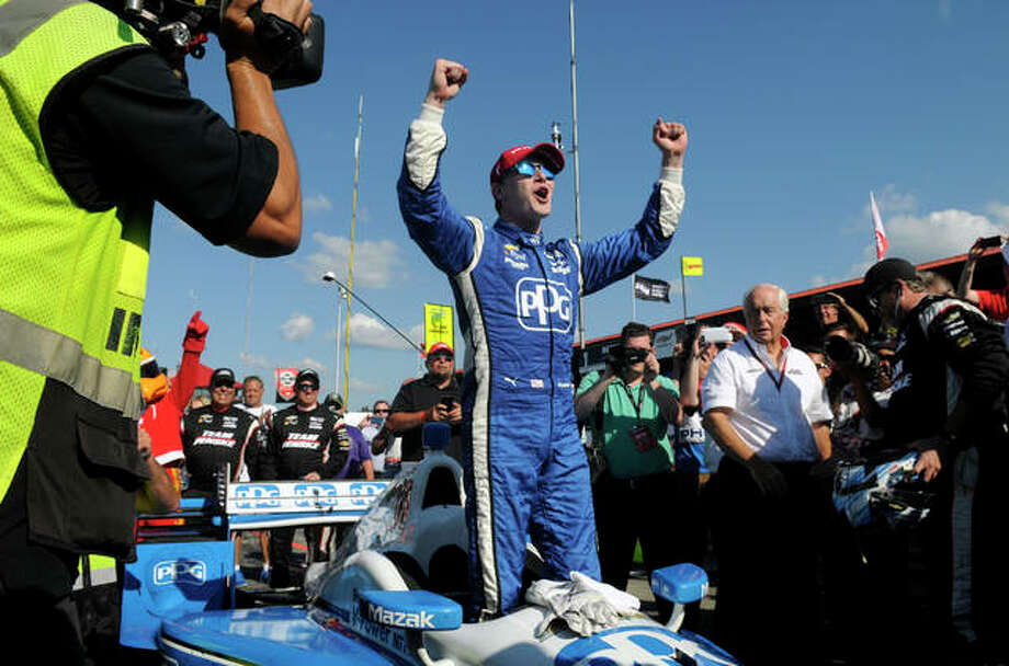 Josef Newgarden won the pole for Saturday's Bommarito 500 IndyCar race at Worldwide Technology Raceway in Madison, Above, he celebrates after winning an IndyCar race in Lexington, Ohio. Photo: AP Photo