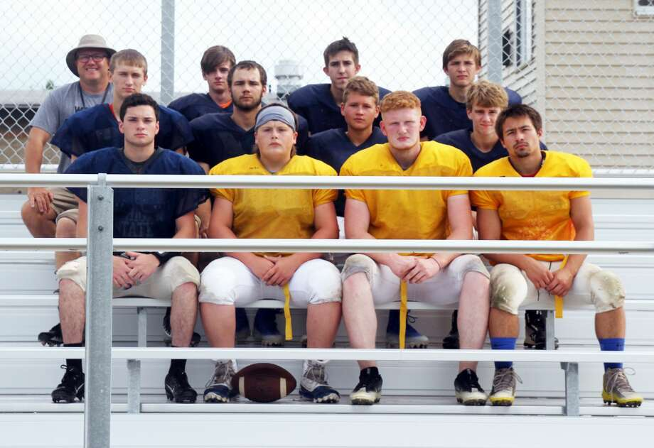Members of the North Huron varsity football team are, front row, from left, Chris Augle, Robby Iseler, Delvin Galleck and Brad Hoody; second row, from left, Joe Weiss, Christian Brown, Cory Kent and Tyler Moore; third row, from left, head coach Chad Knoblock, Ty Woodke, Connor Smith and Justin Helm. Not pictured is assistant coach Troy Hildreth. Photo: Eric Rutter/Huron Daily Tribune