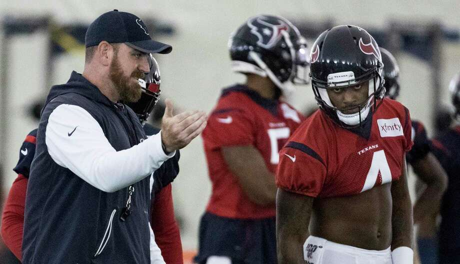 PHOTOS: Texans vs. Jaguars  Houston Texans offensive coordinator Tim Kelly, left, works with quarterback Deshaun Watson (4) during training camp at the Methodist Training Center on Thursday, Aug. 22, 2019, in Houston. >>>See photos from the Texans' first win of the season ...  Photo: Brett Coomer, Houston Chronicle / Staff Photographer / © 2019 Houston Chronicle