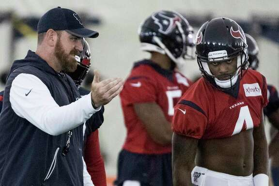 Houston Texans offensive coordinator Tim Kelly, left, works with quarterback Deshaun Watson (4) during training camp at the Methodist Training Center on Thursday, Aug. 22, 2019, in Houston.