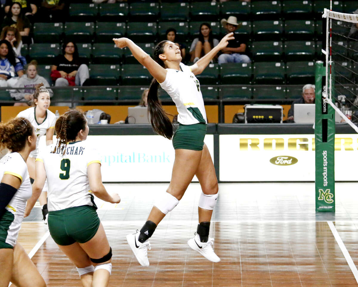MC middle blocker Kirsten Gomez on the attack against Blinn College, Friday at Chaparral Center. Photo courtesy of Forrest Allen, Midland College athletics