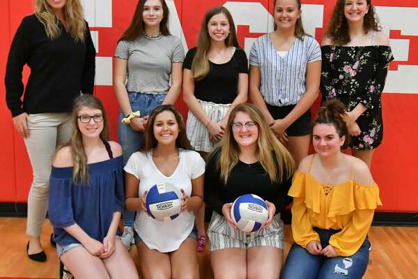 p.p1 {margin: 0.0px 0.0px 0.0px 0.0px; line-height: 10.8px; font: 10.0px Helvetica} Members of the Caseville varsity volleyball team are (front row from left) Alissa Logsdon, Jessica Nugent, Tyonna Ontiveros and Cortney Moody (back row) head coach Samantha Krueger, Ninamarie Quintana, Adrian Ewald, Emma Hopkins and Ashley Guigar. Missing is Nicole Dufty.