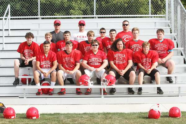 p.p1 {margin: 0.0px 0.0px 0.0px 0.0px; line-height: 10.8px; font: 10.0px Helvetica} Members of the Caseville football team are, front row, from left, Blain Elenbaum, Andrew Bond, Tanner Gast, Blake Newton and Matthew Pedery; middle row, Dominick Madison, Kevin Haag, Steven Wilkins, Nathan Dufty, Jacob Kennedy, Jacob Speare and Charles Witherspoon; back row, assistant coach Adam Figurski, head coach Sam Rogers, water boy Ben Nugent and assistant coach Dave Nugent.