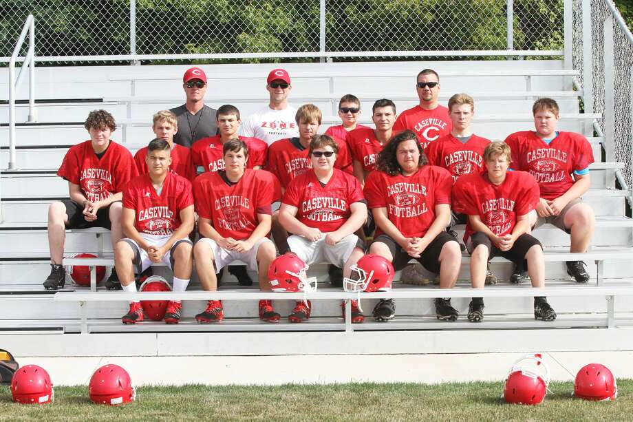 Members of the Caseville football team are, front row, from left, Blain Elenbaum, Andrew Bond, Tanner Gast, Blake Newton and Matthew Pedery; middle row, Dominick Madison, Kevin Haag, Steven Wilkins, Nathan Dufty, Jacob Kennedy, Jacob Speare and Charles Witherspoon; back row, assistant coach Adam Figurski, head coach Sam Rogers, water boy Ben Nugent and assistant coach Dave Nugent. Photo: Eric Rutter/Huron Daily Tribune