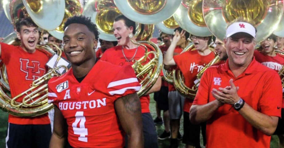 PHOTOS: College football players from the Houston area to watch in 2019 Quarterback D'Eriq King and head coach Dana Holgorsen at UH's annual Cage Rage preseason event at TDECU Stadium on Friday, Aug. 23, 2019. >>>Here are 10 college football players from the Houston area to keep an eye on for the 2019 season ... Photo: Courtesy Of UH