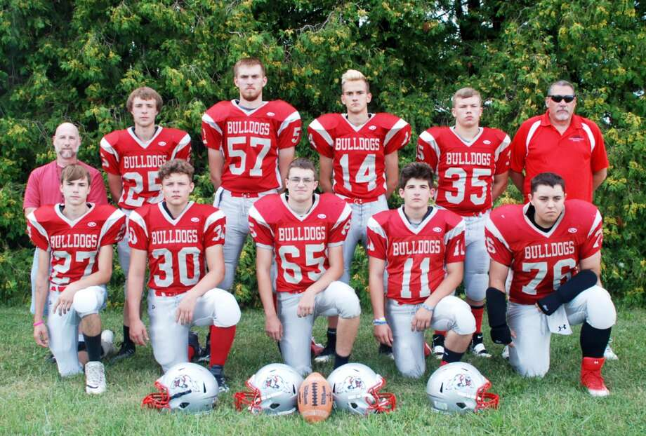 The Owendale-Gagetown varsity football team is, front row, from left, Shane Elliott, Andrew Partaka, Haden Gruehn, Casey Baker, and Brett Watson; back row, from left, head coach Vince Selfco, Ethan Harp, Boyd Evans, Clay Evans, Branden Fritz and assistant Coach Steve Forster. Photo: Julie Warack/ Owendale-Gagetown School