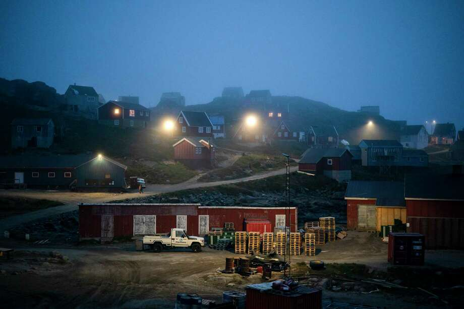 In this Aug. 15, 2019, photo, early morning fog shrouds homes in Kulusuk, Greenland. In tiny Kulusuk, resident Mugu Utuaq says the winter that used to last as long as 10 months when he was a boy, can now be as short as five months. Scientists are hard at work in Greenland, trying to understand the alarmingly rapid melting of the ice. (AP Photo/Felipe Dana) Photo: Felipe Dana / Copyright 2019 The Associated Press. All rights reserved.