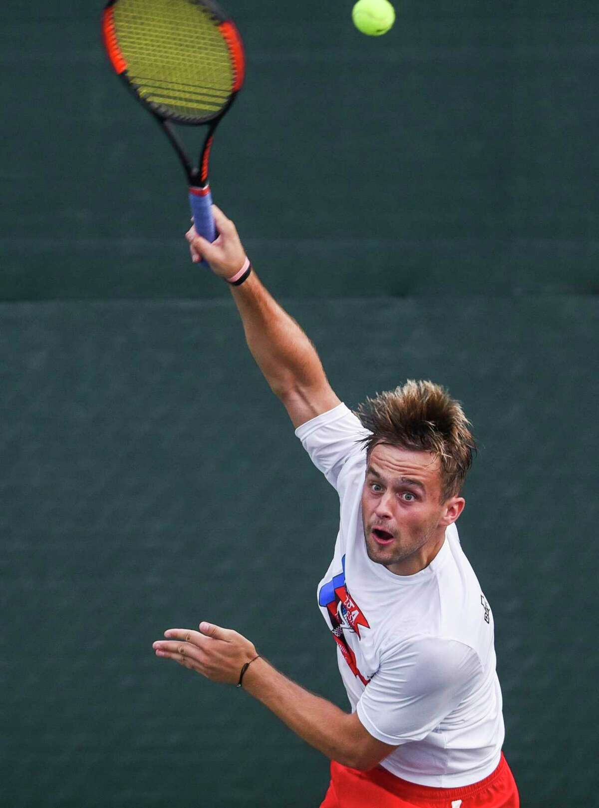 Josh Taylor serves during the Southeast Texas Tennis Association 100th annual Labor Day tournament at the Beaumont Tennis Center on Friday. Photo taken on Friday, 08/22/19. Ryan Welch/The Enterprise