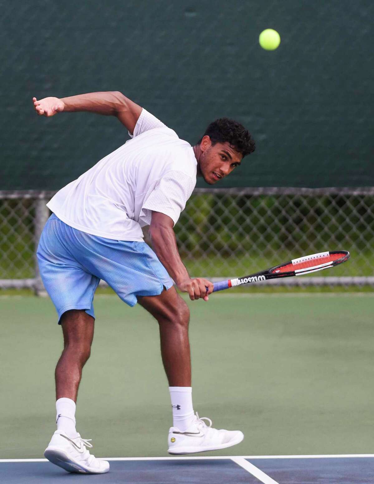 Ashwin Vaithianathan looks back after hitting the ball during the Southeast Texas Tennis Association 100th annual Labor Day tournament at the Beaumont Tennis Center on Friday. Photo taken on Friday, 08/22/19. Ryan Welch/The Enterprise