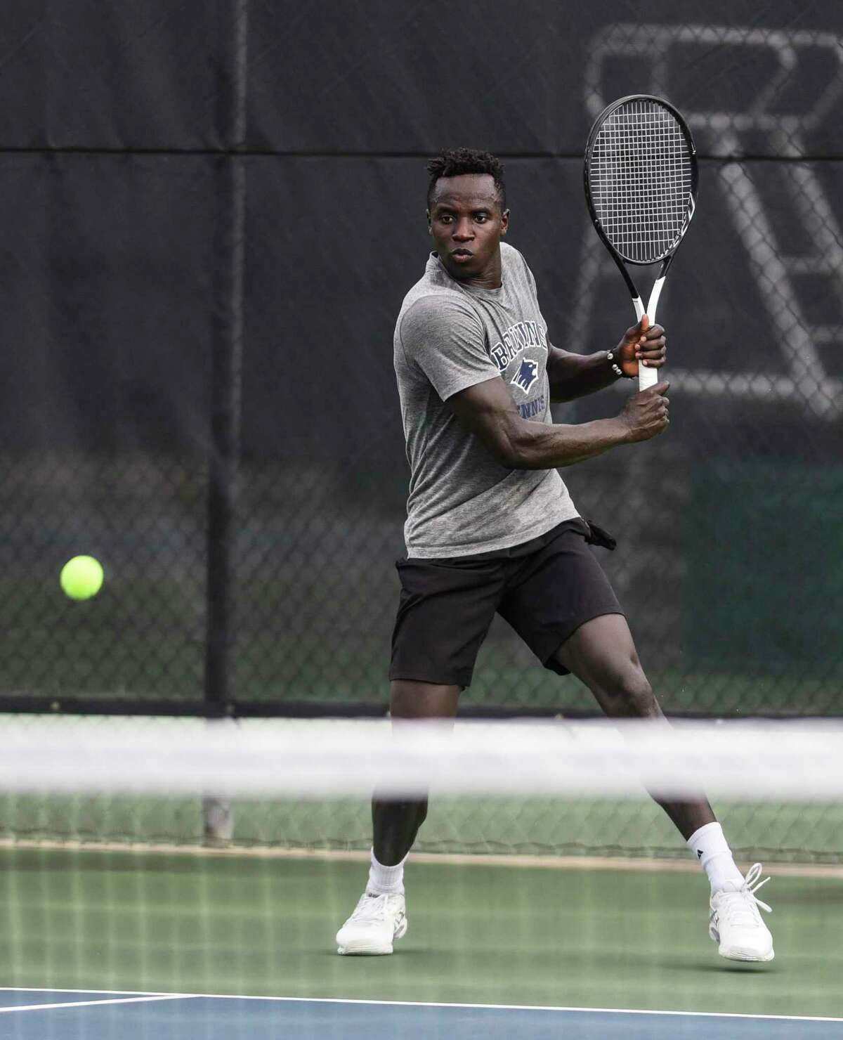 Jonah Wafula returns on serve during the Southeast Texas Tennis Association 100th annual Labor Day tournament at the Beaumont Tennis Center on Friday. Photo taken on Friday, 08/22/19. Ryan Welch/The Enterprise