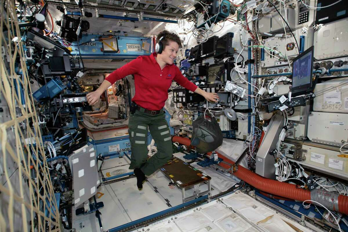 In a photo provided by NASA, Flight Engineer Anne McClain looks at a laptop computer screen inside the U.S. Destiny laboratory module of the International Space Station on Jan. 18, 2019.(NASA via The New York Times)