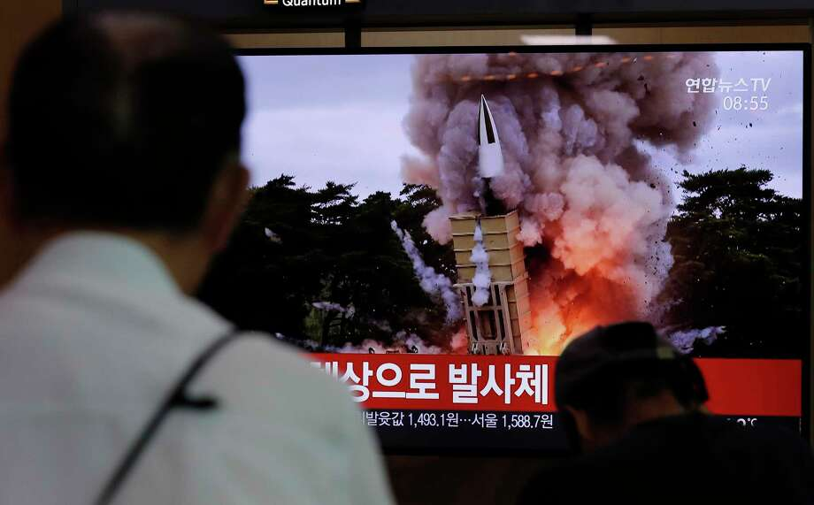 """People watch a TV news program reporting North Korea's firing projectiles with a file image at the Seoul Railway Station in Seoul, South Korea, Saturday, Aug. 24, 2019. North Korea fired two suspected short-range ballistic missiles off its east coast on Saturday in the seventh consecutive week of weapons tests, South Koreaa€™s military said, a day after it threatened to remain Americaa€™s biggest threat in protest of U.S.-led sanctions on the country. The part of Korean letters read: """"Projectiles."""" (AP Photo/Lee Jin-man) Photo: Lee Jin-man / Copyright 2018 The Associated Press. All rights reserved"""