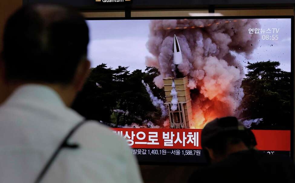 People watch a TV news program reporting North Korea's firing projectiles with a file image at the Seoul Railway Station in Seoul, South Korea, Saturday, Aug. 24, 2019. North Korea fired two suspected short-range ballistic missiles off its east coast on Saturday in the seventh consecutive week of weapons tests, South Koreaa€™s military said, a day after it threatened to remain Americaa€™s biggest threat in protest of U.S.-led sanctions on the country. The part of Korean letters read: