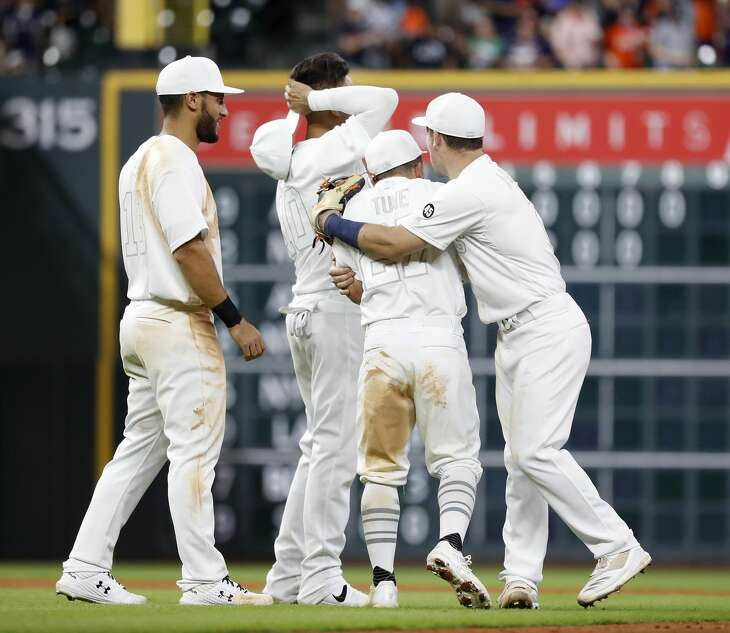 Houston Astros shortstop Alex Bregman (2) celebrates the Astros win over Los Angeles Angels 5-4 by hugging Jose Altuve after the ninth inning of an MLB game at Minute Maid Park, Friday, August 23, 2019.