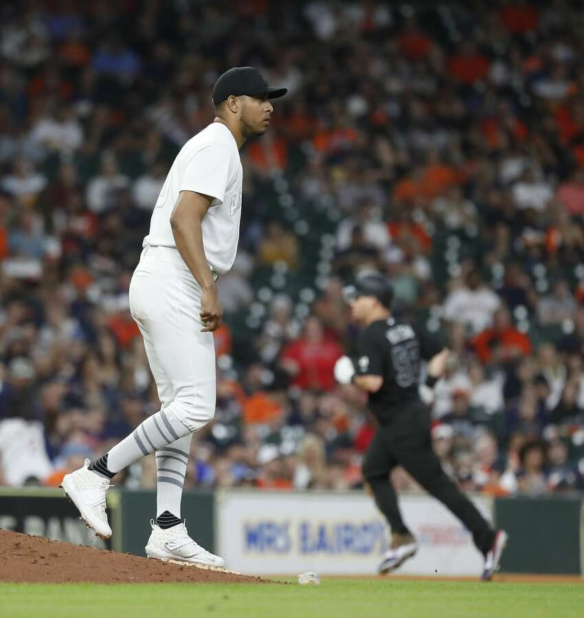 Houston Astros relief pitcher Hector Rondon (30) reacts as Los Angeles Angels Kole Calhoun (56) rounds the bases on his solo home run during the eighth inning of an MLB game at Minute Maid Park, Friday, August 23, 2019.