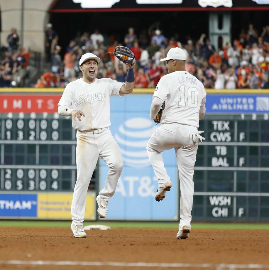 Houston Astros shortstop Alex Bregman (2) celebrates the Astros win over Los Angeles Angels 5-4 with  Yuli Gurriel (10) after the ninth inning of an MLB game at Minute Maid Park, Friday, August 23, 2019. Photo: Karen Warren/Staff Photographer