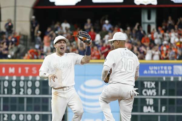 Houston Astros shortstop Alex Bregman (2) celebrates the Astros win over Los Angeles Angels 5-4 with Yuli Gurriel (10) after the ninth inning of an MLB game at Minute Maid Park, Friday, August 23, 2019.