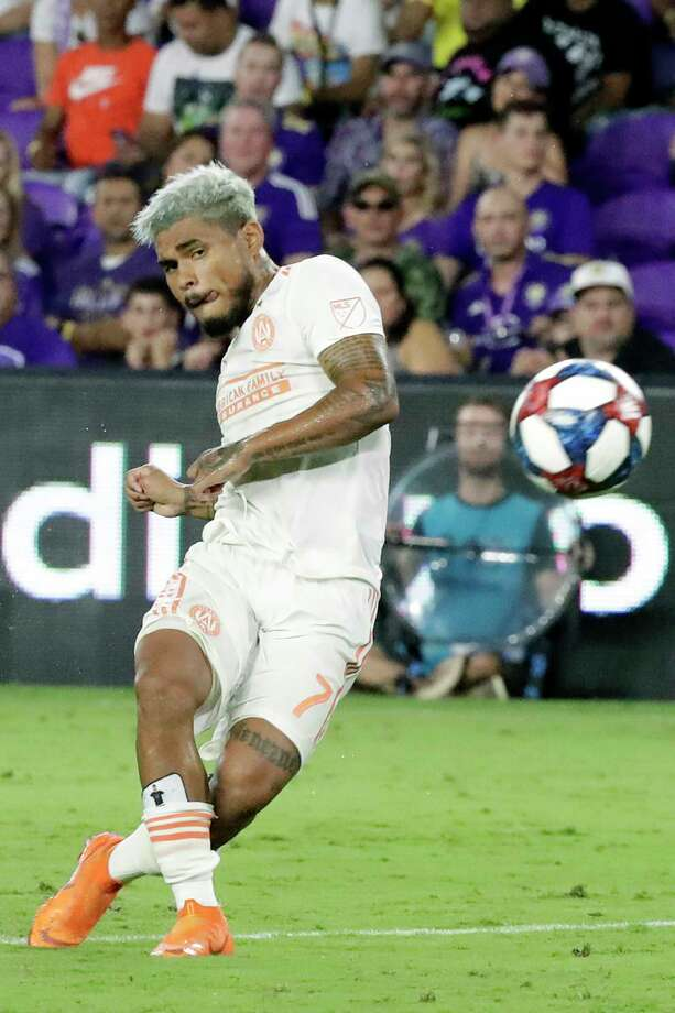 Atlanta United's Josef Martinez shoots and scores a goal against Orlando City during the second half of an MLS soccer match Friday, Aug. 23, 2019, in Orlando, Fla. (AP Photo/John Raoux) Photo: John Raoux / Copyright 2019 The Associated Press. All rights reserved