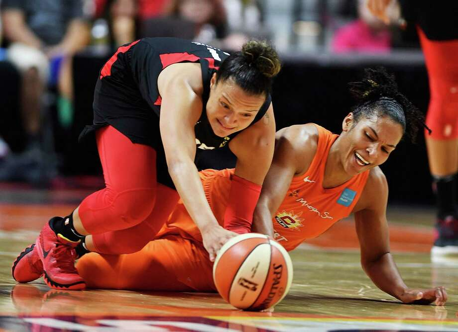 Connecticut Sun forward Alyssa Thomas, right, and Las Vegas Aces guard Kayla McBride dive after a loose ball during Friday's game. Photo: Sean D. Elliot / Associated Press / 2019 The Day Publishing Company