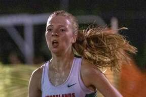 Brooke Forbes of The Woodlands crosses the finish line during the annual Friday Night Lights cross country meet Friday, August 23, 2019 at Bear Branch Fields in The Woodlands.