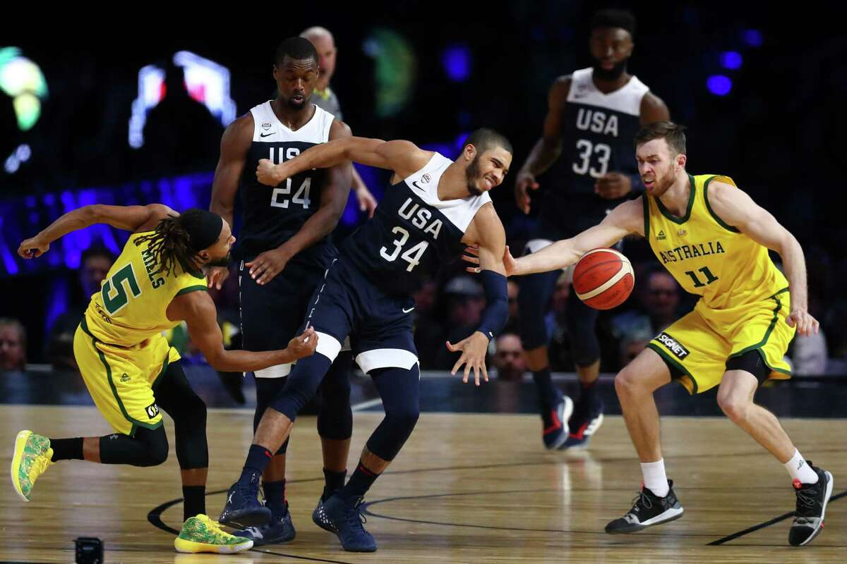 MELBOURNE, AUSTRALIA - AUGUST 24: Patty Mills of the Boomers (L) and Nicholas Kay of the Boomers steal the ball from Jayson Tatum of the USA during game two of the International Basketball series between the Australian Boomers and United States of America at Marvel Stadium on August 24, 2019 in Melbourne, Australia.