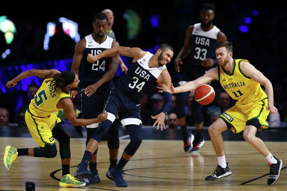 MELBOURNE, AUSTRALIA - AUGUST 24: Patty Mills of the Boomers (L) and Nicholas Kay of the Boomers steal the ball from Jayson Tatum of the USA during game two of the International Basketball series between the Australian Boomers and United States of America at Marvel Stadium on August 24, 2019 in Melbourne, Australia. Photo: Kelly Defina, Getty Images / 2019 Getty Images