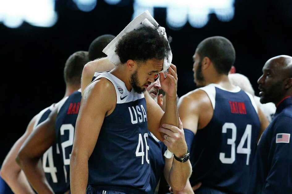 MELBOURNE, AUSTRALIA - AUGUST 24: Derrick White of the USA receives medical attention after hitting the floor during game two of the International Basketball series between the Australian Boomers and United States of America at Marvel Stadium on August 24, 2019 in Melbourne, Australia.