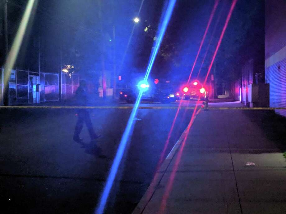 Two people were injured by glass fragments, not bullets, after shots were fired on George Street in Bridgeport Friday night. Photo: CONTRIBUTED PHOTO