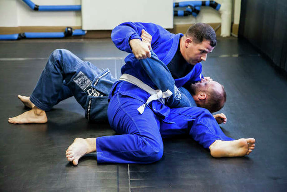 Ryan Fry, left, of Granite City grapples with John Rosner during a Brazilian jiu jitsu training session at Strategic BJJ in Alton where Rosner will be teaching adult kickboxing starting Tuesday, Aug. 27. Strategic BJJ owner Keith Steinacher said Brazilian jiu jitsu challenges a person both physically and mentally. Photo: By Jeanie Stephens|The Telegraph