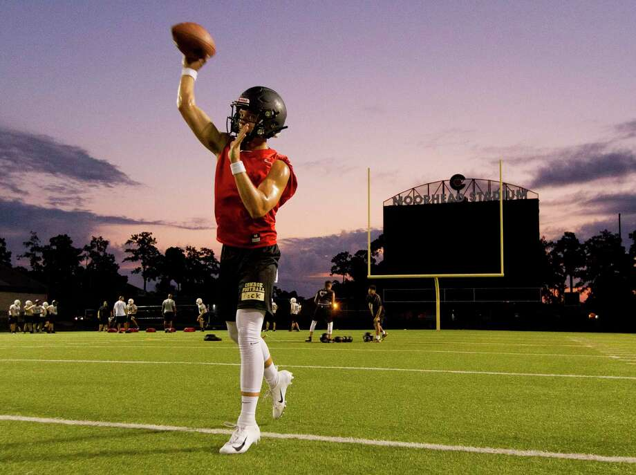Conroe quarterback Christian Pack warms up during the first day of football practice at Buddy Moorhead Stadium on Aug. 5. Photo: Jason Fochtman, Houston Chronicle / Staff Photographer / Houston Chronicle