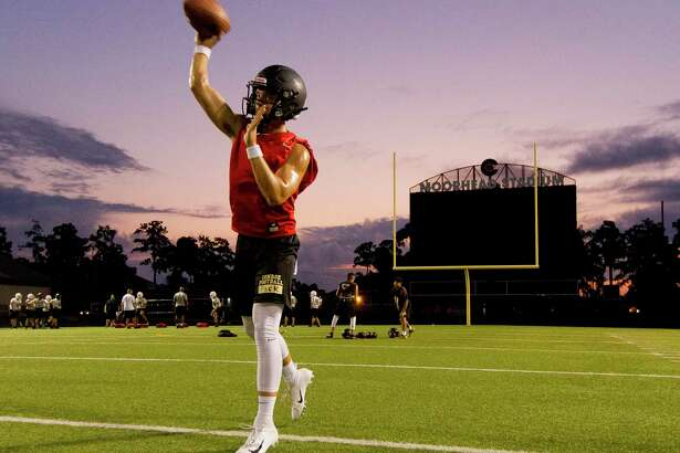 Conroe quarterback Christian Pack warms up during the first day of football practice at Buddy Moorhead Stadium on Aug. 5.