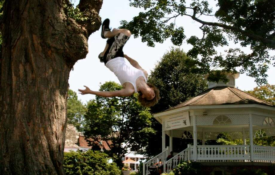 Jeff Felner, 18, a recent graduate of Fairfield Ludlowe High School, backflips off an oak tree at Sherman Green's park. Photo: Contributed Photo, Contributed Photo / Paul Hoffman / Fairfield Citizen