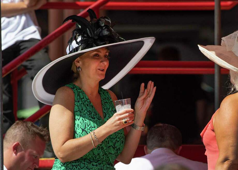 A race patron shows off her beautiful hat as she speaks with another patron on Travers Day 150 at the Saratoga Race Course Saturday Aug. 24, 2019 in Saratoga Springs, N.Y. Photo special to the Times Union by Skip Dickstein