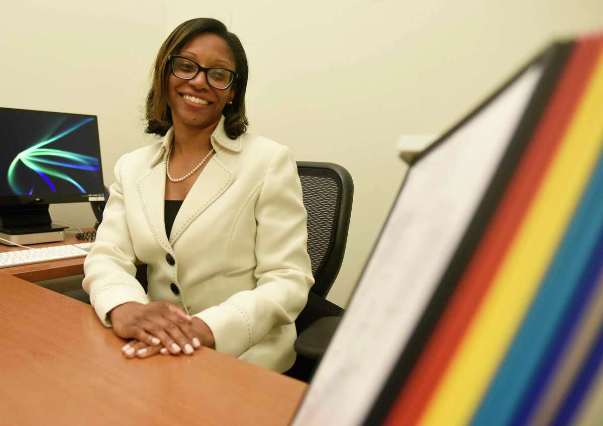 Incoming Principal Shanta Smith poses in her office at Hamilton Avenue School in the Chickahominy section of Greenwich, Conn. Wednesday, Aug. 22, 2019.