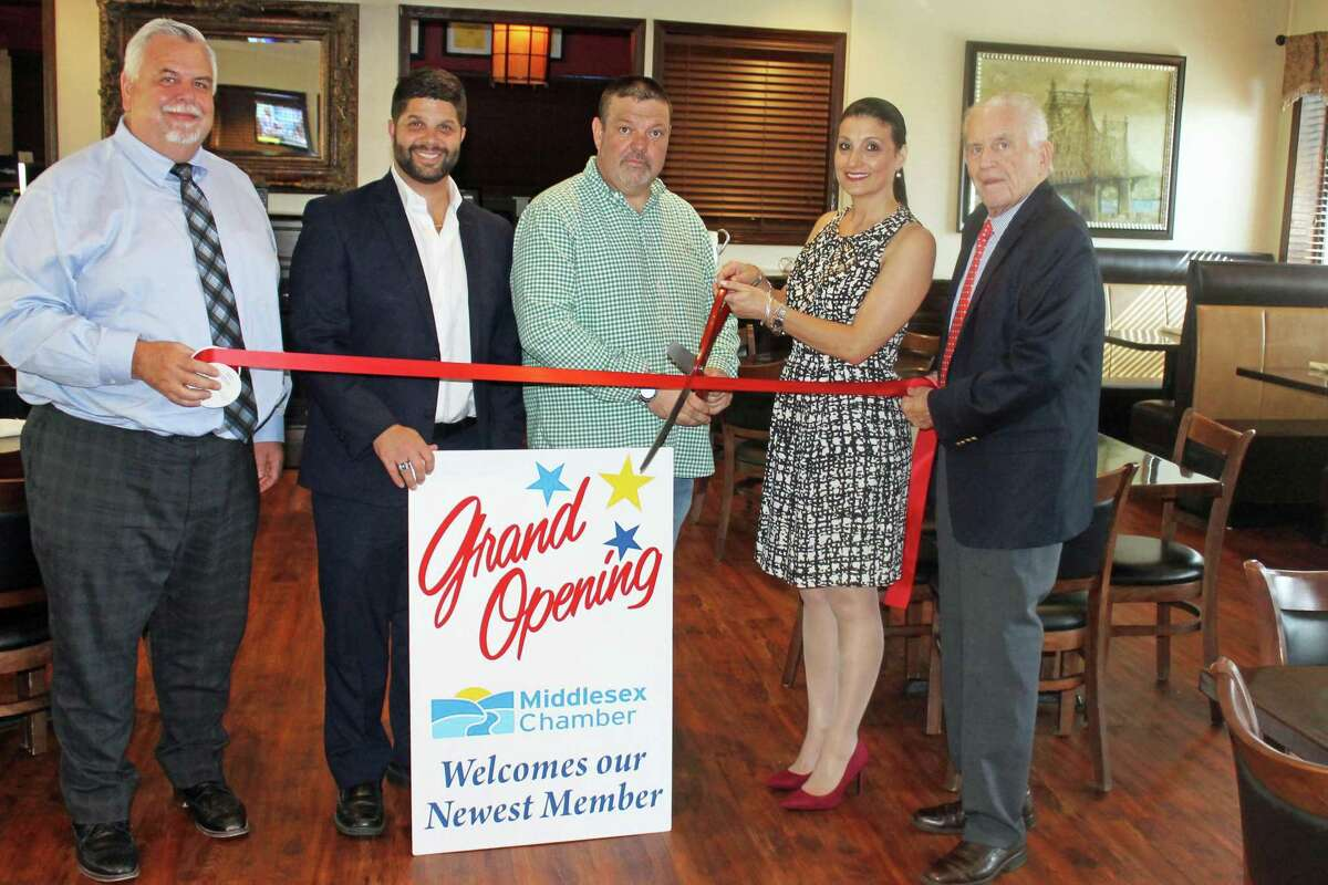 Nino's Restaurant, an Italian restaurant at 825 Saybrook Road, Middletown, held a grand opening Aug. 22. From left are Middlesex County Chamber of Commerce Chairman Don DeVivo, Mayor Dan Drew, owners Bill and Eleanor Anderson, and Chamber President Larry McHugh.