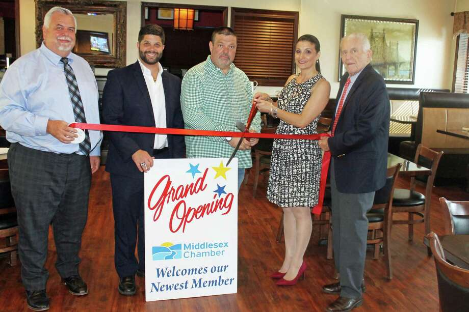Nino's Restaurant, an Italian restaurant at 825 Saybrook Road, Middletown, held a grand opening Aug. 22. From left are Middlesex County Chamber of Commerce Chairman Don DeVivo, Mayor Dan Drew, owners Bill and Eleanor Anderson, and Chamber President Larry McHugh. Photo: Contributed Photo