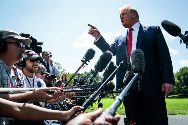 President Donald Trump talks to reporters outside the White House on Wednesday.