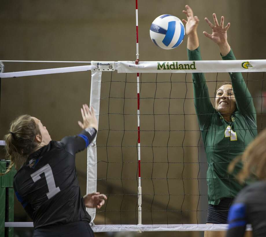 Midland College's Lina Espejo Ramirez gets up to block a shot by Western Texas College's Mackensi Christian 08/24/19 in the Midland College Kickoff Classic at the Chaparral Center. Tim Fischer/Reporter-Telegram Photo: Tim Fischer/Midland Reporter-Telegram