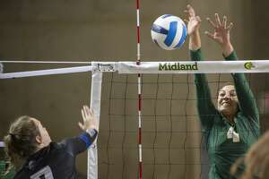 Midland College's Lina Espejo Ramirez gets up to block a shot by Western Texas College's Mackensi Christian 08/24/19 in the Midland College Kickoff Classic at the Chaparral Center. Tim Fischer/Reporter-Telegram