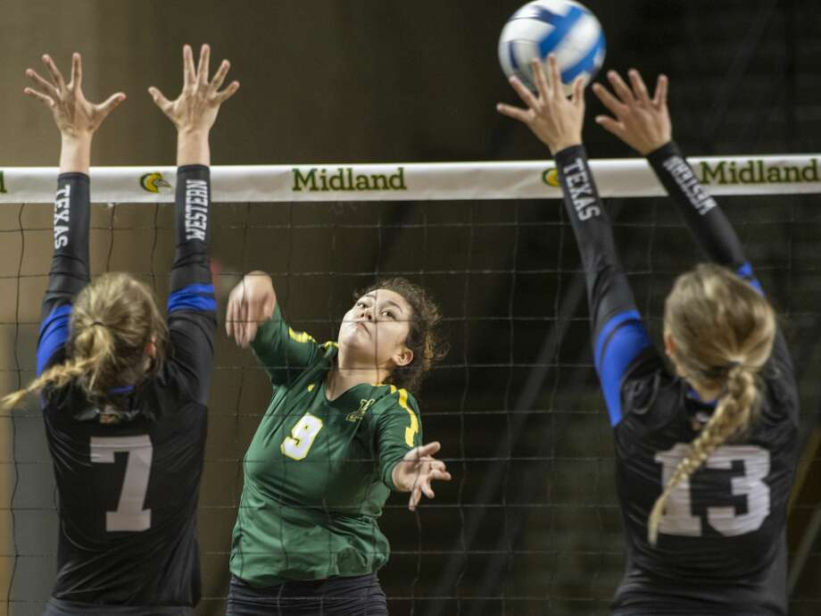 Midland College's Lesly Galarza tries to hit the ball between Western Texas College's Mackensi Christian and Landry Oliver 08/24/19 in the Midland College Kickoff Classic at the Chaparral Center. Tim Fischer/Reporter-Telegram Photo: Tim Fischer/Midland Reporter-Telegram