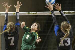 Midland College's Lesly Galarza tries to hit the ball between Western Texas College's Mackensi Christian and Landry Oliver 08/24/19 in the Midland College Kickoff Classic at the Chaparral Center. Tim Fischer/Reporter-Telegram