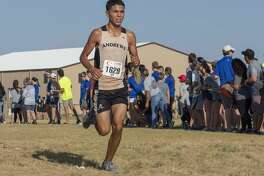 Andrews' Jasson Marquez races to the finish line in third place 08/24/19 morning in the boys Division 1 Tall City Cross Country Invitational at Rock the Desert grounds. Tim Fischer/Reporter-Telegram