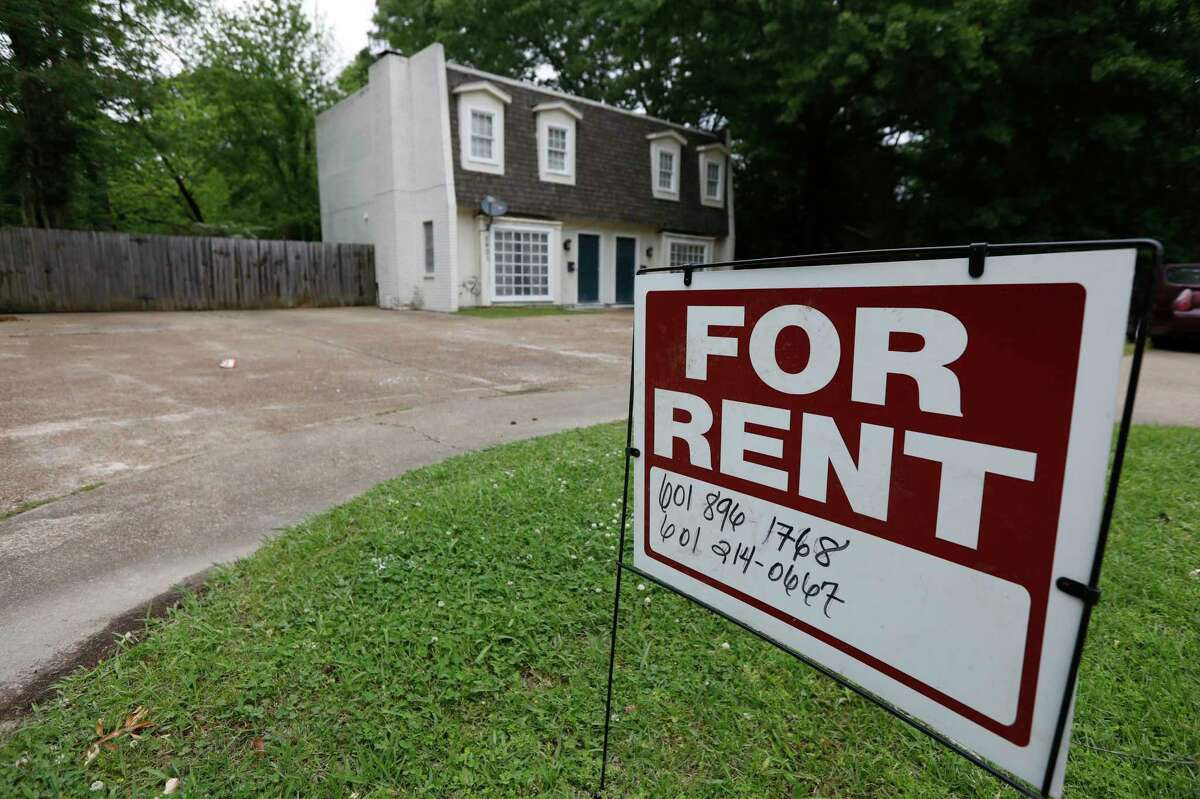 FILE - In this April 23, 2018, file photo a for rent sign denotes the availability of another existing home in Jackson, Miss. Millennials are delaying homeownership and staying in leased housing longer than previous generations, studies show. (AP Photo/Rogelio V. Solis, File)