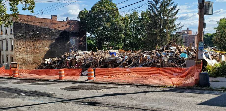 By Saturday afternoon, rubble was all that was left of five homes destroyed in a Friday morning fire on Myrtle Avenue in Albany. (Chris Churchill/Times Union) Photo: Chris Churchill / Times Union