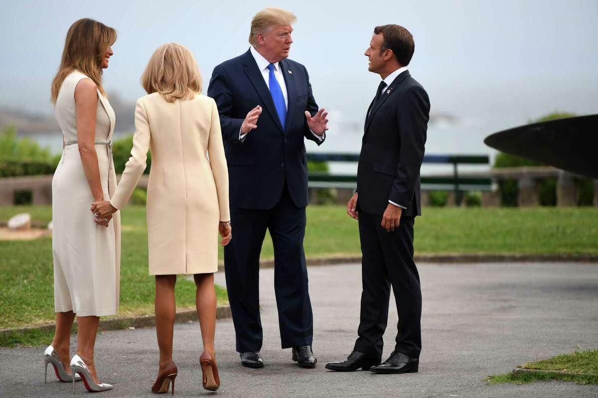 BIARRITZ, FRANCE - AUGUST 24: French President Emmanuel Macron (R) and his wife Brigitte Macron (2nd L) welcome US President Donald Trump (2nd R) and his wife US First Lady Melania Trump (L) ahead of a working dinner at the Biarritz lighthouse on August 24, 2019 in Biarritz, France. The French southwestern seaside resort of Biarritz is hosting the 45th G7 summit from August 24 to 26. High on the agenda will be the climate emergency, the US-China trade war, Britain's departure from the EU, and emergency talks on the Amazon wildfire crisis. (Photo by Pool/Getty Images)