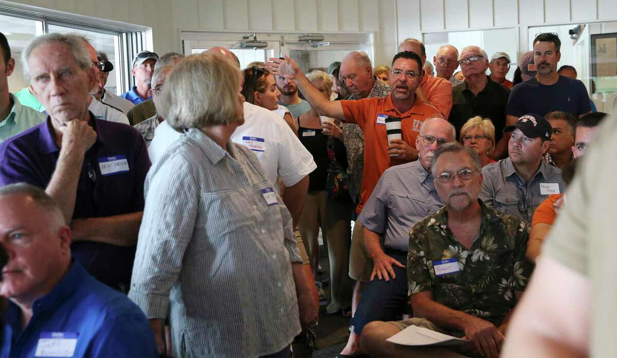 Residents ask questions as the group, Citizens United for Lake Placid, holds a meeting about the future of the lake on Aug. 24, 2019. The meeting went over plans to stop the Guadalupe-Blanco River Authority from draining Placid and three other lakes on the Guadalupe River, starting Sept. 16.