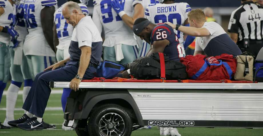 Houston Texans running back Lamar Miller (26) is carted off the field after suffering an unknown injury in the first half of a preseason NFL football game against the Dallas Cowboys in Arlington, Texas, Saturday, Aug. 24, 2019. (AP Photo/Michael Ainsworth) Photo: Michael Ainsworth/Associated Press